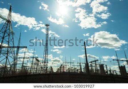 High voltage electrical  towers against blue sky - stock photo