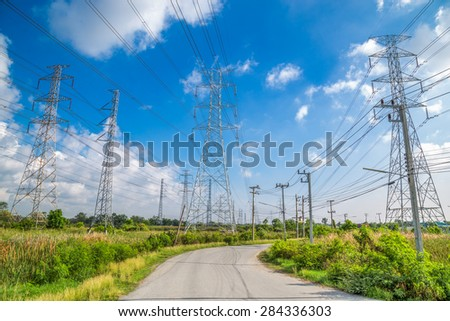 High voltage electricity pylon with blue sky background - stock photo