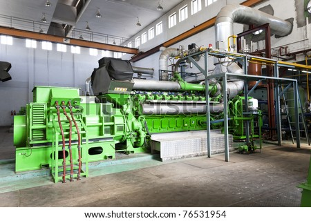 high voltage industrial standby dieasel generator at a power generation plant in a textile factory. - stock photo
