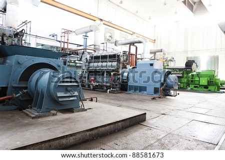 high voltage industrial standby diesel generator at a power generation plant in a textile factory. - stock photo