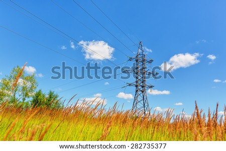 High voltage line beneath the blue sky - stock photo