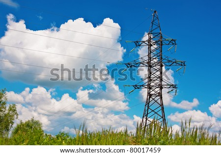 High voltage lines on a background of the blue cloudy sky - stock photo