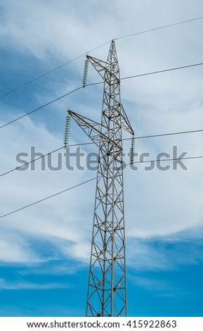 High voltage pole on cloudy sky. - stock photo