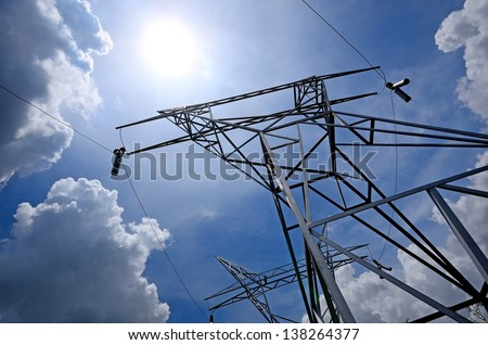 High voltage pole on sunlight blue sky energy and technology industry for design - stock photo