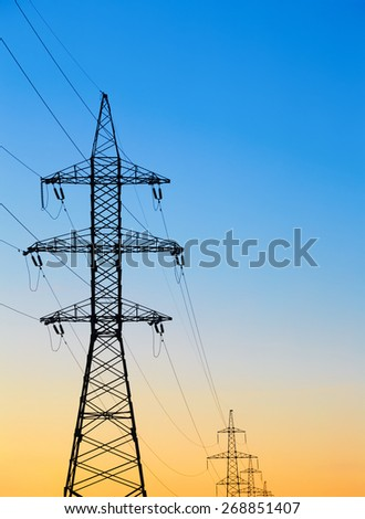 high voltage post against the evening or morning sky - stock photo