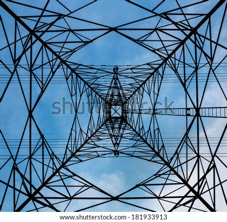 High voltage post and blue sky - stock photo