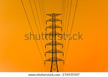 High voltage post.High-voltage tower silhouette - stock photo