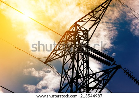 High voltage post or High voltage tower - stock photo