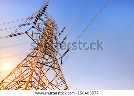 High voltage post or High voltage tower at sunset - stock photo