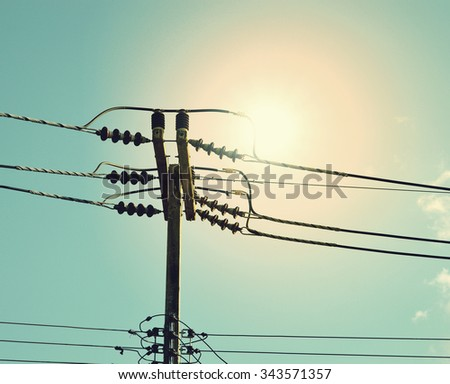 High voltage post or High voltage tower at sunset - vintage filter effect - stock photo