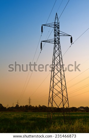 High voltage post or High voltage tower at twilight time - stock photo