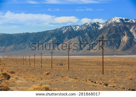 High voltage power lines near Sierra Nevada mountains, California - stock photo