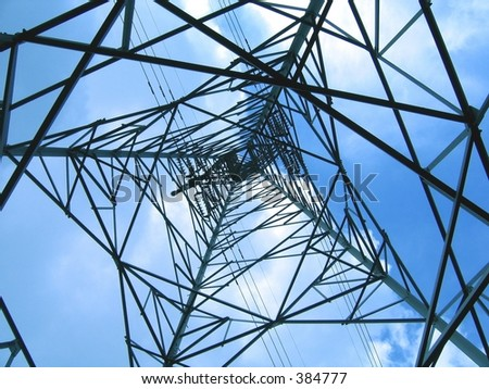 High Voltage Power Mast -- large iron structure set against the sky - stock photo