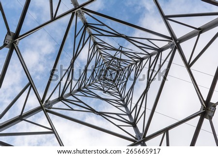 High Voltage Power Pole against the sky - stock photo