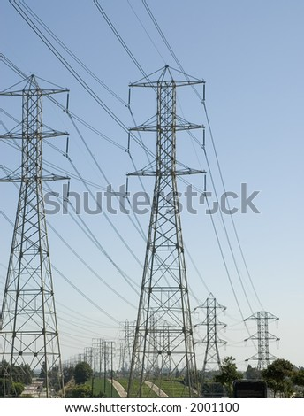 high voltage power tower carrying electricity to homes and businesses - stock photo