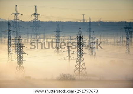 High voltage power transmission towers - stock photo