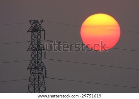 high voltage pylon with sunset - stock photo
