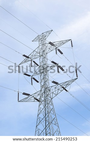 High voltage pylons and power lines to the power station  - stock photo
