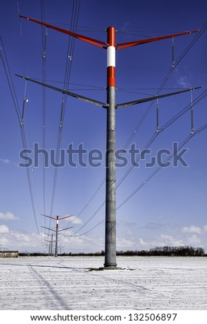 High voltage pylons in a modern design - stock photo