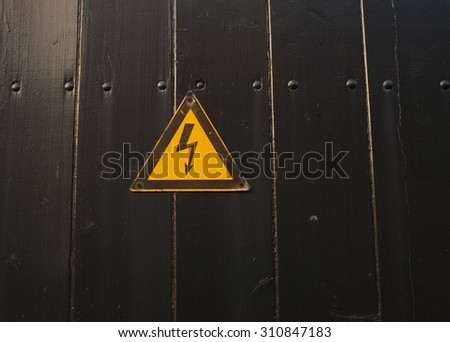 high voltage sign on black painted wood  - stock photo