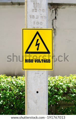 High voltage sign on electric pole ,isolated on white - stock photo