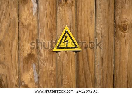 High voltage sign on wood background  - stock photo