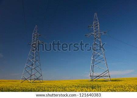 High-voltage tower against the blue sky - stock photo