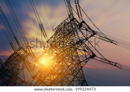 High voltage tower at sunset - stock photo