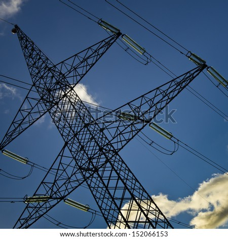 High voltage Tower, tilt viewpoint, clean blue sky - stock photo