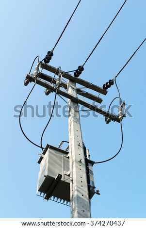 High Voltage Transformers on the pole. - stock photo