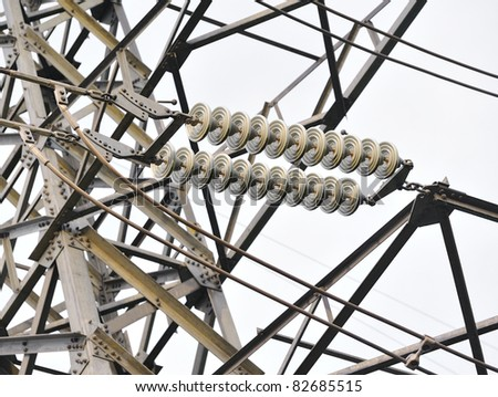 High voltage transmission power line and glass isolators - stock photo