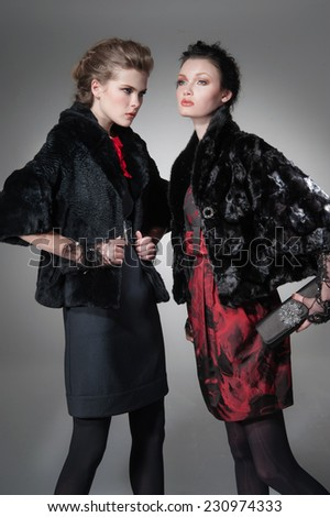 high Young fashion two girl wearing elegant black clothes - stock photo
