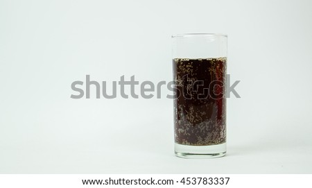 Highball glass with a cola soda pop drink. - stock photo
