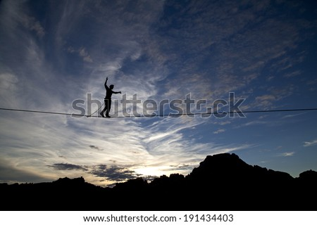 Highline walker silhouette with nice sunset - stock photo