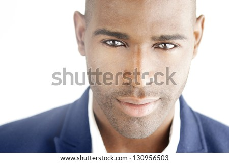Highly detailed close-up portrait of a young smart successful business man - stock photo