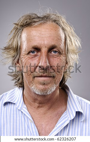Highly detailed portrait of an older man, wrinkled and balding - stock photo