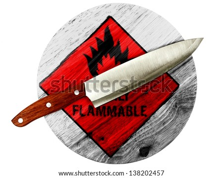 Highly flammable sign drawn on  painted on wooden board with knife - stock photo
