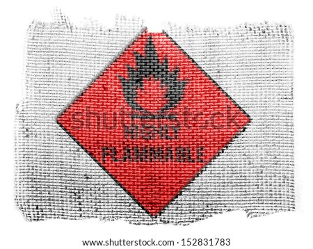 Highly flammable sign drawn on  piece of fabric - stock photo