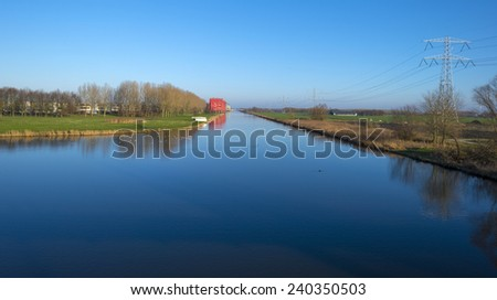 Highrise along a canal under a sunny sky - stock photo