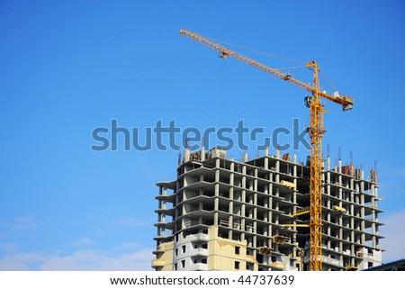 Highrise Construction Site on clear blue sky (look similar images in my portfolio) - stock photo