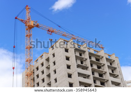 Highrise cranes and construction landscape - stock photo