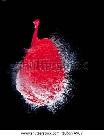 highspeed photo of water filled bursting balloon - stock photo
