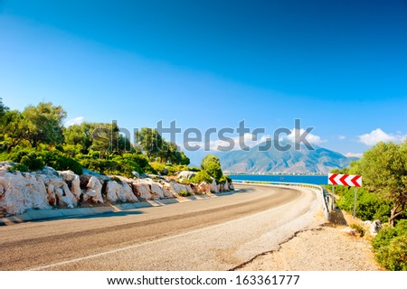 highway along the sea on a background of mountains - stock photo