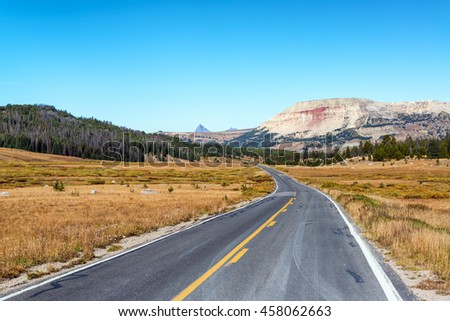 Highway and beautiful view in Shoshone National Forest in Wyoming - stock photo
