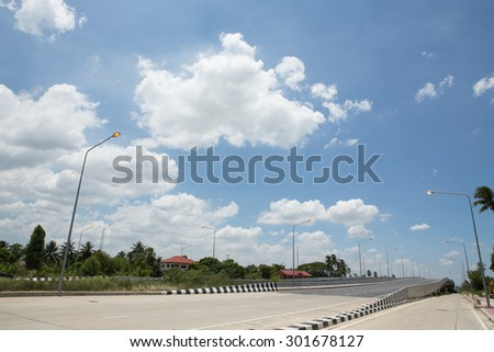 highway and blue sky - stock photo
