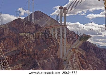 Highway and bridge being built in mountains - stock photo