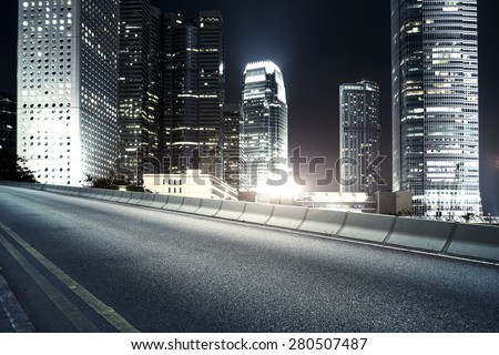 Highway and city at night - stock photo