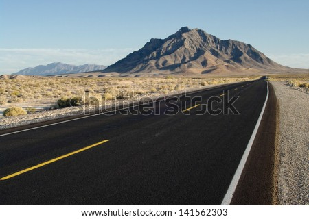 Highway 127 and Eagle Mountain, California, USA. On Hwy 127, south of Death Valley Junction. - stock photo