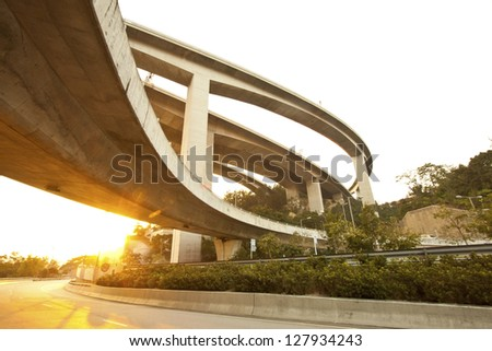 Highway and freeway at sunset in Hong Kong - stock photo