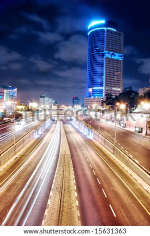 highway and modern building night scene - stock photo